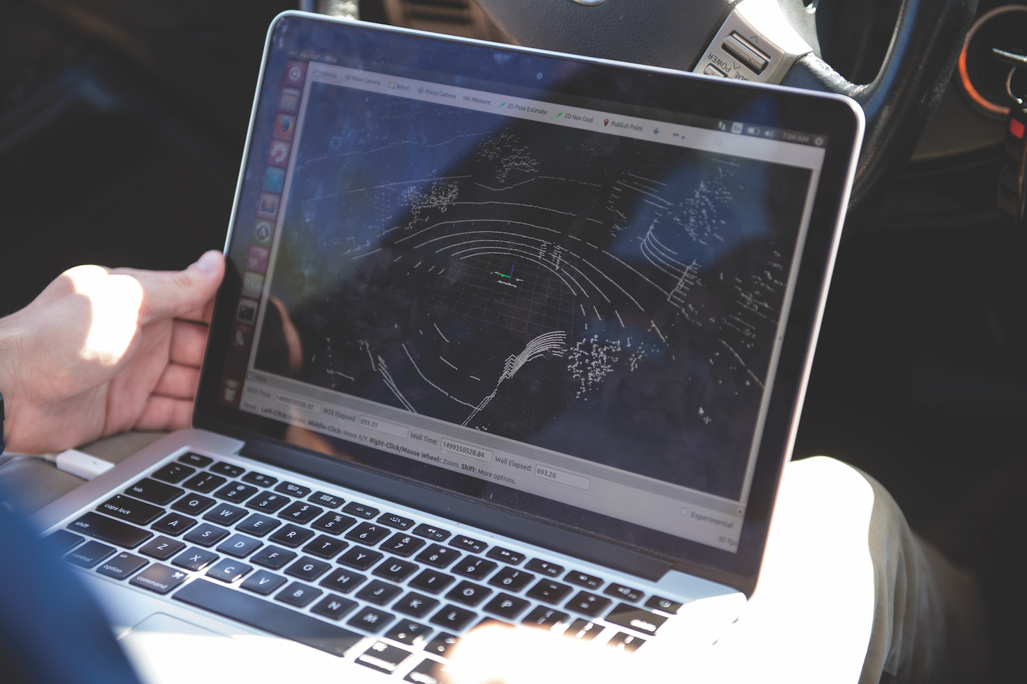 An Auburn University students monitors truck platooning testing on a laptop computer.