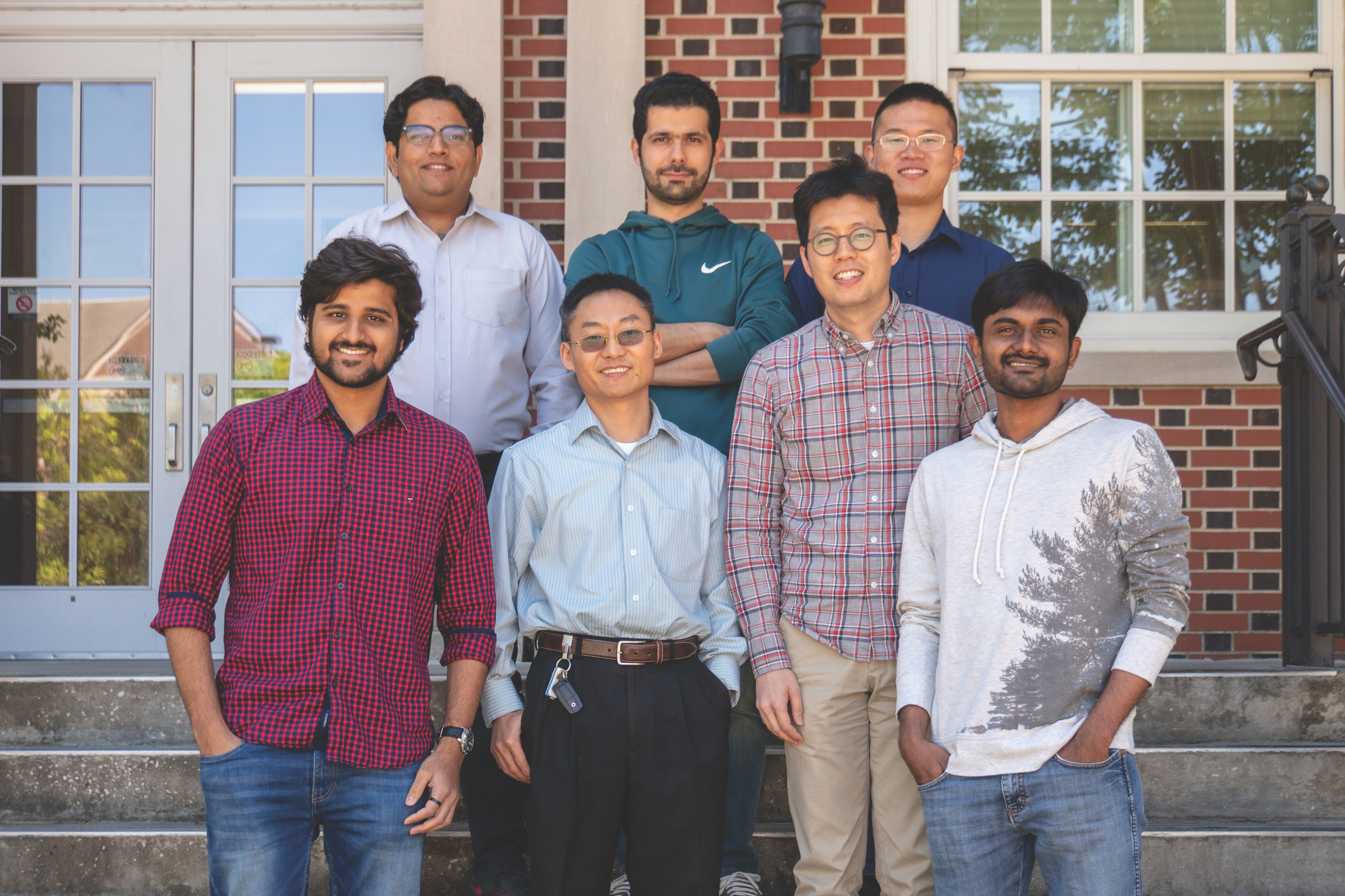 Principal investigator Peter He's team consists of graduate students (front, L-R) Kerul Suthar, Peter He, Jangwon Lee, Devarshi Shah, (back) Arsslan Tahir Bhatti, Farshad Amiri and Feifan Cheng.