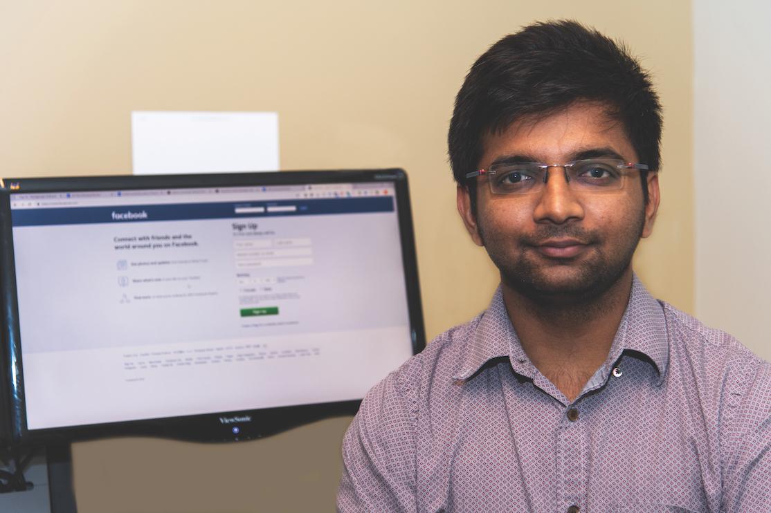 Nirmit Patel poses on the campus of Auburn University.