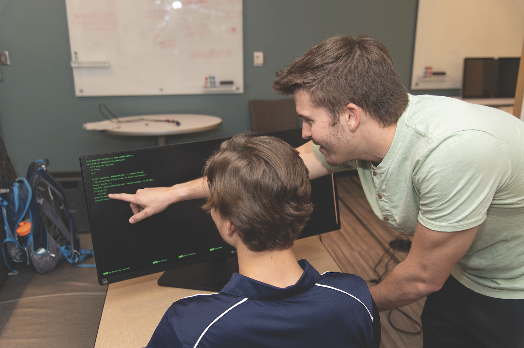 Auburn students studying computer code.