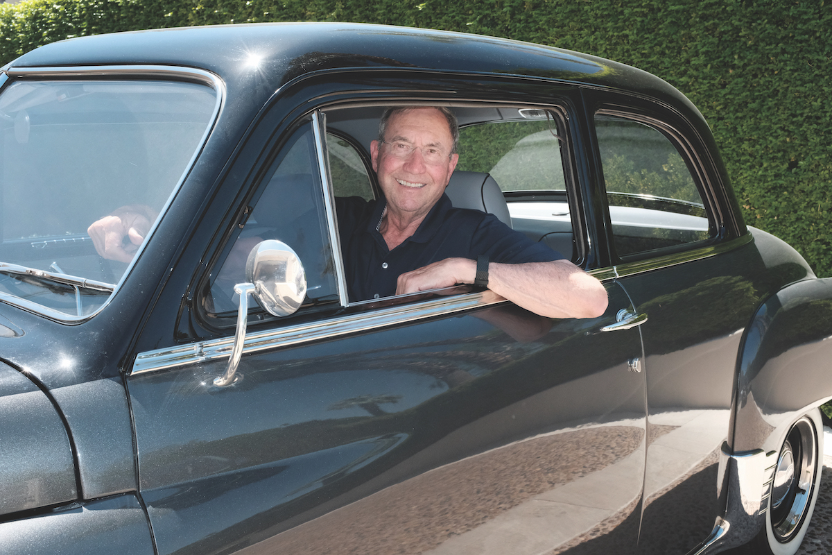 Sam Ginn in his 1950 Plymouth Deluxe.