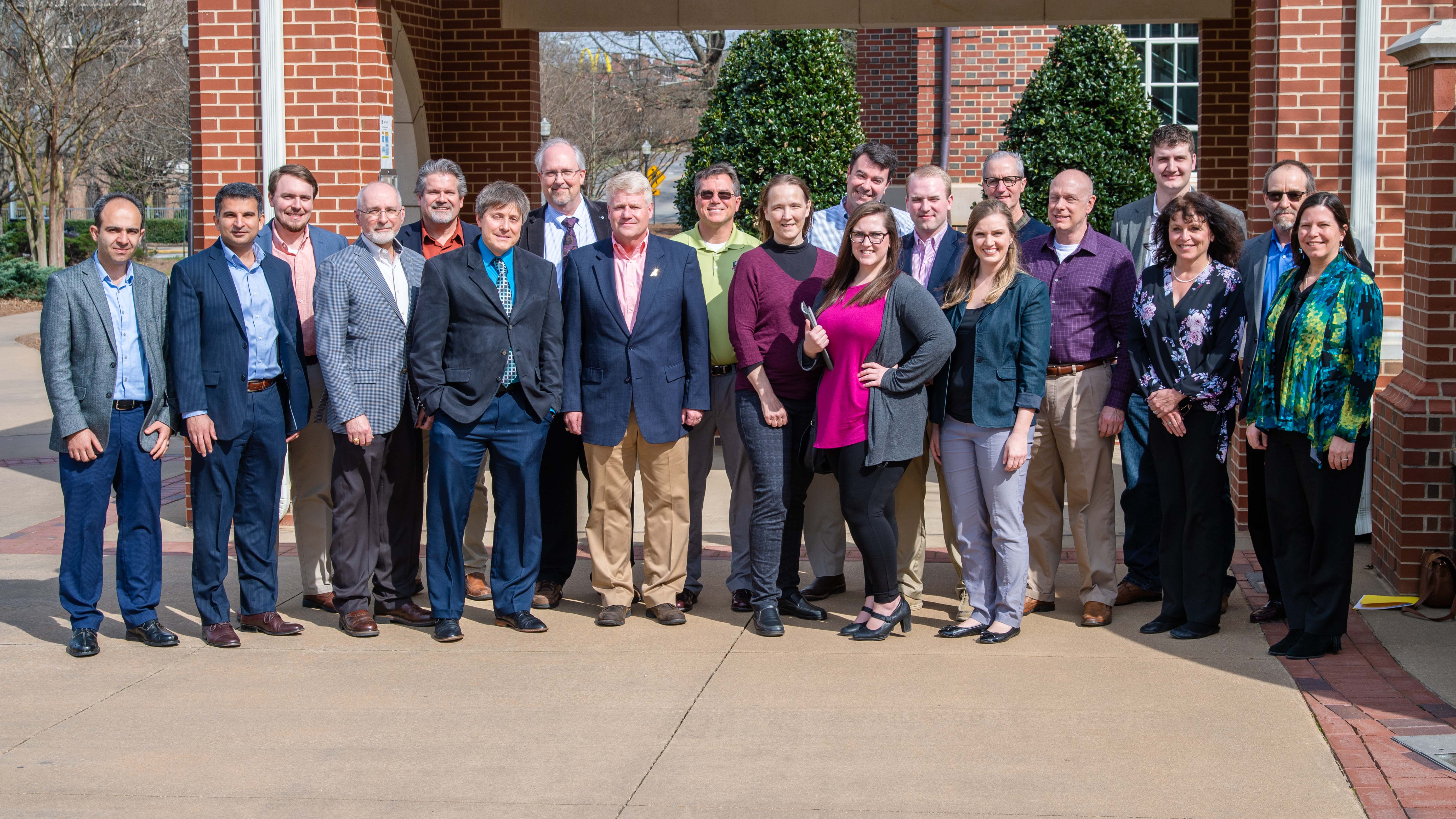 Representatives from the Team Redstone Additive Manufacturing Integrated Product Team (IPT) pose with the staff of Auburn University's National Center for Additive Manufacturing Excellence, or NCAME.