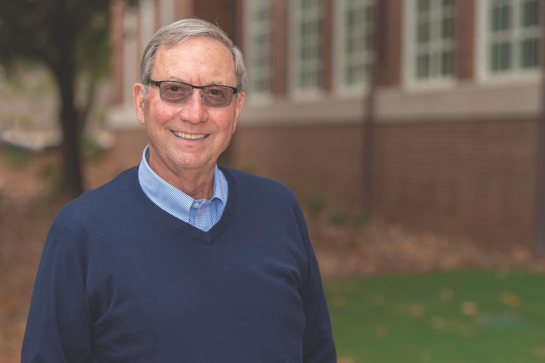 Samuel Ginn poses on the campus of Auburn University.